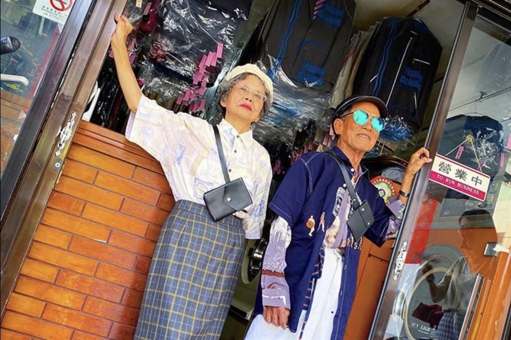 Chang Wan-chi and Hsu Hsiu-e outisde their laundomat
