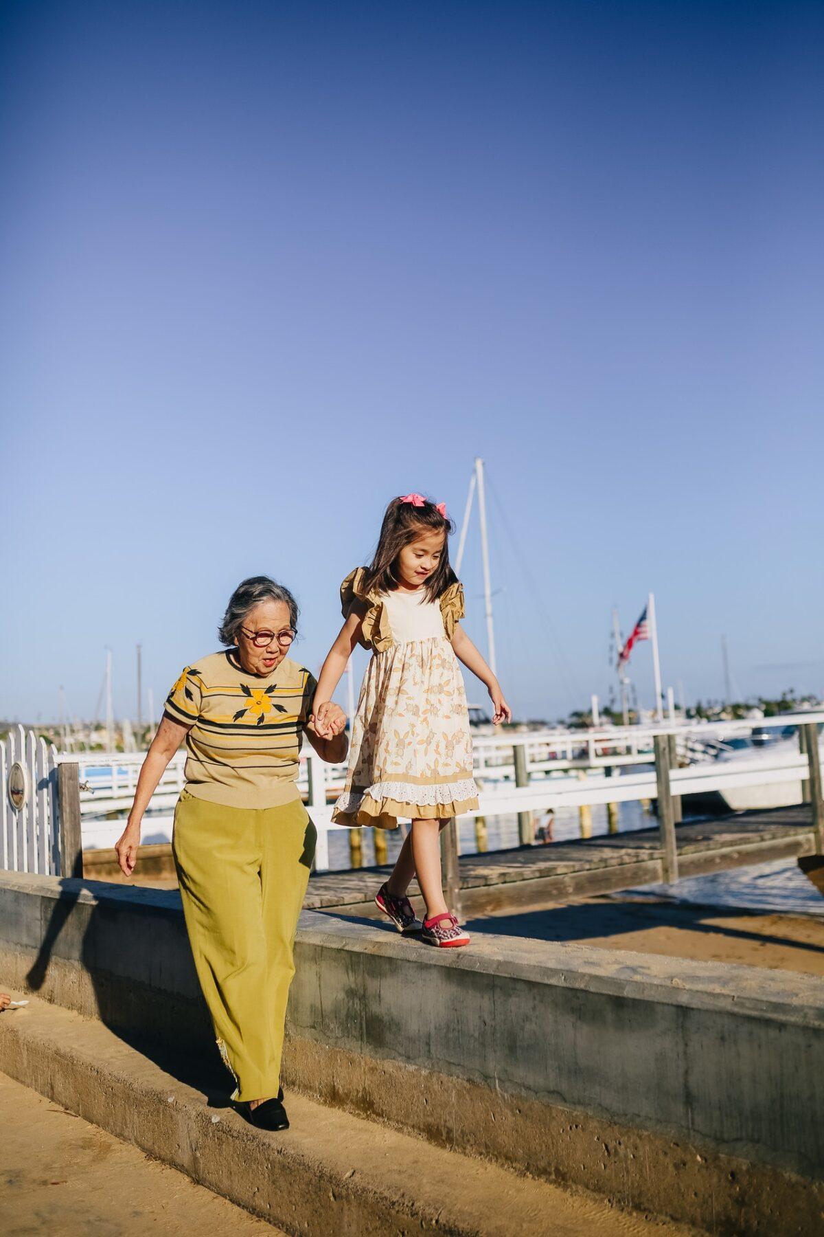 grandma and granddaughter by pier